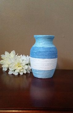 Check out this item in my Etsy shop https://www.etsy.com/listing/234700393/blue-striped-yarn-wrapped-vase-blue-yarn