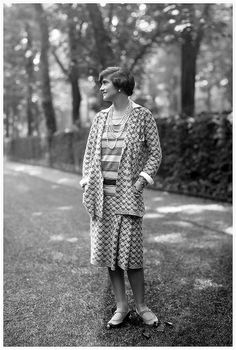 Coco Chanel wearing one of her suits in the grounds at Fauborg, St Honoré, Paris 1929