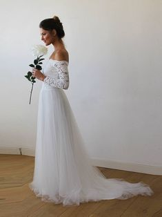 long sleeve lace and tulle wedding dress
