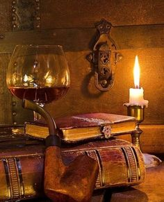 old leather books, trunk, wine and candle
