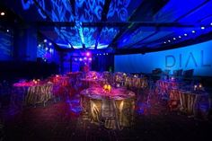 Gold linen and clear acrylic seating and gold metalic linen combine with specialty blue lighting in order to achieve an AVATAR effect for this corporate dinner. Jpatrick Designs for