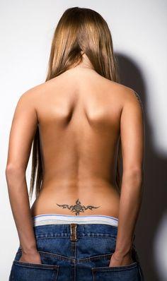 Small lower back tattoo.