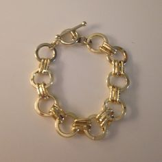 Link bracelet Shiny gold color costume jewelry - wear alone or layered! Adds a pop of classic shine to any outfit. Bar and loop closure. Jewelry Bracelets