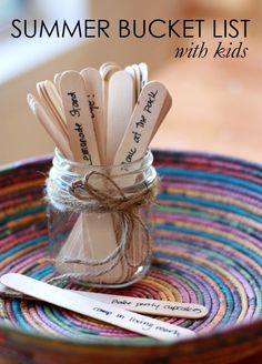 Love Summer Bucket List Ideas + Activities listed on popsicle sticks in a mason jar! this is like a really good idea because when your board, pull a bucketlist idea out of the jar and do that one!!
