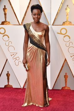 Lupita Nyong'o in custom Atelier Versace, Alexandre Birman shoes, Niwaka jewelry, and with a Versace clutch