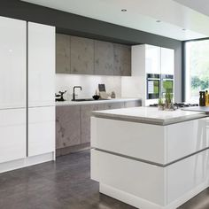 High gloss kitchen Doors are visually stunning, hard-wearing and epitomise a modern home. With lighter colours in particular, gloss reflects natural light and creates a sense of space. Combine this with a simple slab or handleless door and the effect is accentuated. If you have a small kitchen or a kitchen with little natural light, this on-trend look could be the very thing. Check out Zurfiz in Ultragloss Glacier White & Magma Titanium- shown here in a stylish True Handleless kitchen… High Gloss Kitchen Cabinets, White Gloss Kitchen, Kitchen Cabinet Styles, Kitchen Cabinet Doors, Replacement Kitchen Doors, Handleless Kitchen, Feature Wall Bedroom, Kitchen Collection, Kitchen Sets