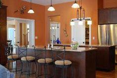 Deep orange kitchen walls are cozier and more zen than you would think! House, Kitchen Colors, Orange Kitchen, Home Remodeling, Apartment Makeover, Kitchen Renovation, Orange Kitchen Walls, Dining Room Accents, Kitchen Cabinet Color Schemes