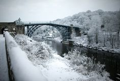 Heavy snow covers the Ironbridge World Heritage Site. The world's first cast iron bridge was built over the River Severn at Coalbrookdale in Winter Wonderland Pictures, Abraham Darby, River Severn, Picture Postcards, Over The River, Places Of Interest, World Heritage Sites, First World, Bridges