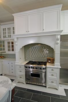 Kitchen with white cabinets and aqua subway & harlequin tile backsplash -- Artistic Designs for living
