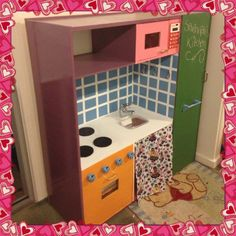 What my daughters father made her from an old tv unit. A play kitchen