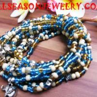 Multi seeds bead stretch bracelet. Notice how the strands are held together one string wrapped several times around them.