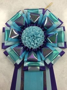 View our collection of ribbons and rosettes available in accents including floral, patterned, glittery golds, silvers and more. Ribbon Rosettes, Ribbons, Centaur, Dog Show, Photo Galleries, Projects To Try, Wreaths, Gallery, Floral