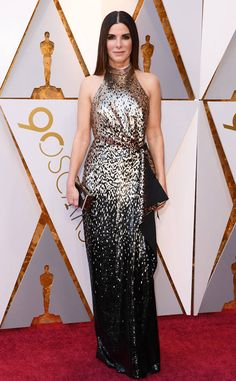 Sandra Bullock from Standout Style Moments From Oscars 2018  The A-lister wore a multi-hued halter dress paired with slick-straight hair.