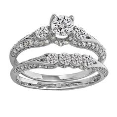 This lovely diamond ring set features 1 1/2 carat of prong-set round-cut diamonds in a classic three-stone-setting. The 14-karat gold bands have a high-polish finish for extra shine.
