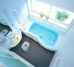 Japanese designers TOTO and INAX specialize in small bathroom layouts where tub and shower are combined and the whole floor drains water. The floor and the mirror have built-in heating.