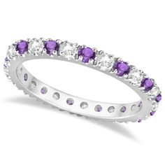 14 purple Amethysts and 13 brilliant-cut white round diamonds are circling all the way around this unique and modern gemstone eternity band for women.