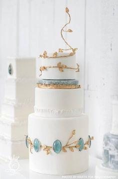 Scandinavia-inspired white, gold and jade wedding cake.