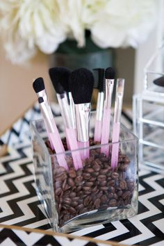 Fill a flower vase with coffee beans or beads, and stick your brushes inside for easy access.