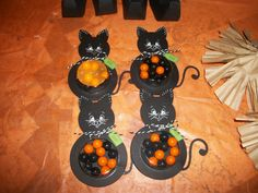 Halloween cats I made using my cricut to weld 2 circles together, su treat cups filled with sixlets, su blossom punch for the ears and ek success punch for the tail and peachy keen stamps for the faces