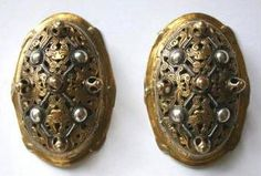 Love the mixed metal turtle brooches. 10th century Swedish/ Rus. http://www.mirdrevnostei.ru/index.php?productID=3282 Store ships internationally.