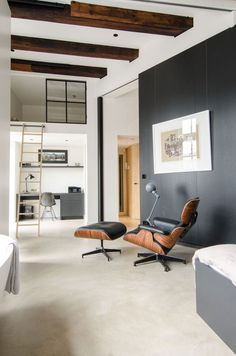 A contemporary masculine loft in Amsterdam by @standardstudio love the Eames lounge chair