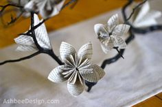 This is a Very Popular look right now and this Blog shows you how to do it yourself!! Book Page Flower centerpiece by AshbeeDesign.com