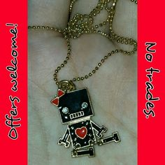 I-Robot into your heart necklace! *NWOT!* This little necklace is super cute! It's black and red with little rhinestone eyes and gold-color outlining. The little legs move! There's absolutely nothing wrong with it, I just never got around to using it. It's pretty small but still makes a statement. Make this cutie yours! -Offers welcome! -No trades Urbanog Jewelry Necklaces