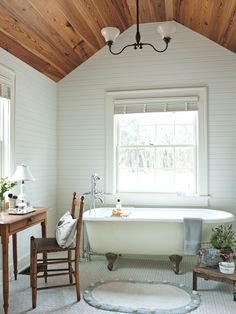 Bathroom in restored cottage at The Ford Plantation with beadboard walls, antique lighting fixture, authentic clawfoot tub and hexagonal tiled floors |  Architecture:  Historical Concepts  | Photo:  Deborah Whitlaw Llewellyn