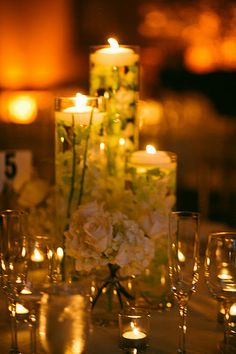 orchid and hydrangea centerpieces with tons of candles and very dim lighting