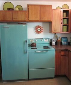 I had these exact cabinets in my second home. I love the look and feel of Birch. Those copper handles are classics!