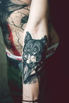 I want a wolf on my left shoulder that starts on the outside as geometric and just line art, but then grows in detail and shading with the eyes being the center and completely detailed