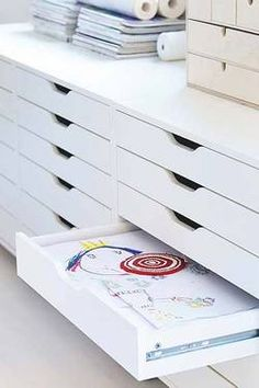 Ikea Alex drawers. (I'd also LOVE these for the classroom. Great way to keep memory book art organized.)