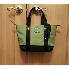 Franco Sarto Handbag Small handbag with big color! Used only a few times. Green with black trim. Black patent leather detail; tiny scuff on back. Floral lining. Inside/outside pockets, cell phone pouch. Inside light not working, maybe needs battery. Franco Sarto Bags