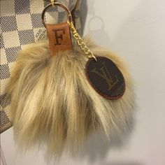 XL personalized faux fur Pom Super soft long hair shaggy faux fur Pom hand sewn by me. Your initial hot stamped on vachetta leather hanger strap; two sided leather charm made from authentic LV canvas from a vintage bag.  Available in other colors and sizes. Comment with your specifics. Firm posh price; no trades. Accessories