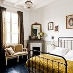 Country Bedroom with Wrought Iron Vintage Bed