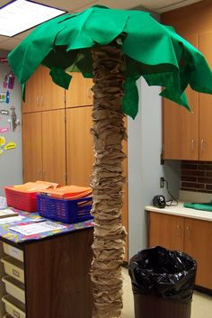 Around the pole in my classroom that the kids can't stop climbing. Ill make a tree