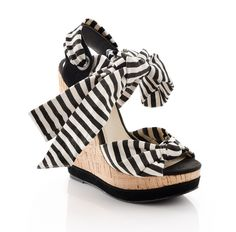 Adorable black and white stunners are spotlight-worthy to say the least. With 50s inspired stripes, a cork wedge, and an adorable ankle tie, you'll be pin-up ready in no time. #shoes #sandals #womens #beauty #fashion #ladies #girls #summer