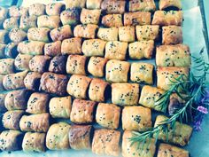 Homemade sausage rolls, with Italian meat ball filling - basil, parsley and Parmesan. Full recipe at www.dericiousfood.com