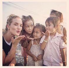 Rosie with the village children doing charity work.