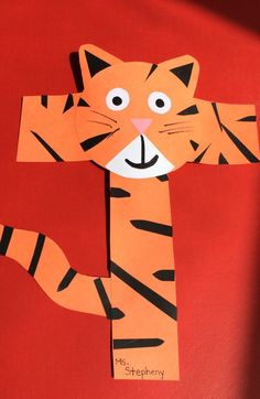 lower case: t tiger. I would put the head higher up so the cross bar looks like arms. Preschool Letter Crafts, Alphabet Letter Crafts, Abc Crafts, Preschool Projects, Daycare Crafts, Animal Alphabet, Classroom Crafts, Preschool Crafts, Alphabet Book