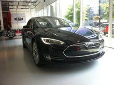 "The Model S electric sedan sits in a Tesla showroom in Washington, D.C. A start up car company? Cool! I like the ""frunk"""