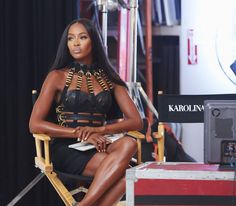 Naomi Campbell in a vintage Versace gold hardware-embellished leather bondage dress from Resurrection paired with strappy Louboutins.
