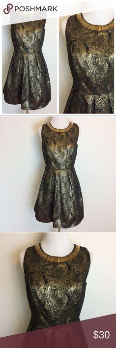 "Romeo & Juliet Couture Gold Black Metallic Dress Romeo + Juliet Couture Gold and Black Metallic Sleeveless dress. Size Small. Back zipper. Underarm measurement is 16.5"". Waist is 13.5"" across. 85% polyester• 15% cotton. Fully lined. 100% polyester. Romeo & Juliet Couture Dresses"