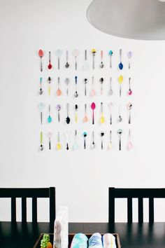We've all seen the bins of loose, mismatched flatware at Goodwill. Take a bunch of spoons home, dip them in paint, then mount in a pattern or grid on wall. A Joyful Riot hung these up in her dining room with a bunch of Command velcro strips. So colorful, and so very inexpensive.