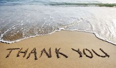 thank you written in the sand