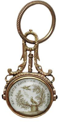 "~ In this French watch fob, a husband's dedication to his late wife reads, ""the further apart, the tighter the bond."" ~"