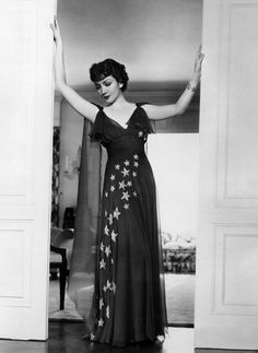 Claudette Colbert in a starry dress..