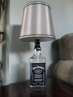 Recycled Liquor Bottle Lamp Tutorial- Jack Daniels  -Supposedly you can make these for under $10 (not including how much you spend for the actual booze) and these can go from $30-$40 easily.