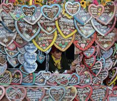 A woman selling gingerbread hearts works on her booth at the Oktoberfest beer festival at the Theresienwiese fair grounds on Oct. 2