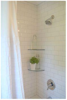 Glass corner shelves in shower.